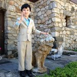 My grandson, Denis, with one of two lions that guard the front door.