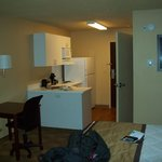 Enter room thru kitchenette, a swivel chair available at table