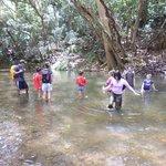 Crossing Wailua in waist deep water