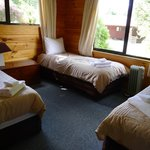 Room with 3 single beds