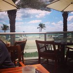 Lunch on the patio looking at the beach! Great spot for breakfast, lunch and dinner!