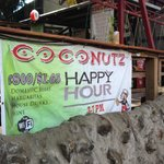 Out door happy hour advertising Coconutz Sports Bar & Eatery  |  Main St, Playas del Coco 5019,