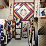 This is part of the quilt room where there are dozens and dozens of beautifully handmade quilts.
