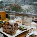 Steak, vegetables, beer, wine and a view.