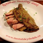 Potato pancake with sauerkraut and smoked meat. Delicious!