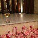 outside spa full of rose petals looking out to our private pool