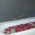 bathtub full of rose petals on arrival