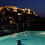 Pool side night view of Acropolis