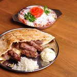 Cevapi with traditional cheese cream