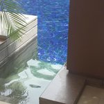 A swimming pool in front of your door step. How cool!