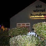 Old Wirral Hundred lit up at night