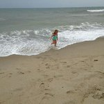 Granddaughter playing in the surf behind our hotel the Southwind.