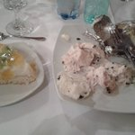 the desert and the left-overs, all together on our table at Panoramic Restaurant Unirea Hotel..b