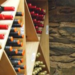 One section of our on-site wine cellar with historic stonework from 1849
