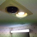 Naked bulb in master bathroom