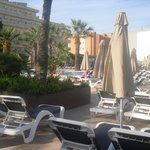pool area plenty of sunbeds and bar close by