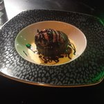 Chocolate molten cake with house made strawberry sorbet