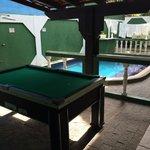 Mesa de bilhar e piscina