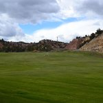 part of the golf course at Thunderbird, with the highway to Zion behind