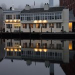 Our little home away from home reflected in the Mystic River