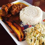 Stewed chicken with fries plantain and coleslaw