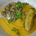 fresh fish filletwith vegetables on vellutata and pepper filled