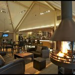 Welcoming bar with cosy fire at The Courtyard Bar & Restaurant, Kenmore