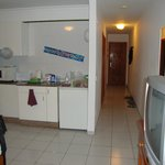 Kitchen area and hallway to bathroom and bedroom