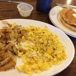Scrambled eggs, hash browns and pancakes