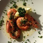 Tiger prawns cooked in garlic butter with Taylor's crusty bread .