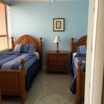 2nd bedroom with two twin beds - window view of the ocean