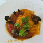 Crab and lobster ravioli with a tomato and mussels sauce. Perfect balance of flavours!