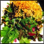 Introductory salad - fresh leaves tossed in a light Japanese dressing