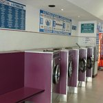 very clean laundry 2 blocks from hotel if u need.  30 minute wash, 30 minute dry, bar across the