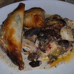 Rabbit Spanakopitas with potatoes, olives, yogurt, cucumber, and liver.