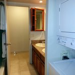 Bathroom with washer and dryer provided