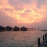 Sunset over water villas