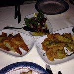 Clockwise from left Spanakopita, grilled octopus and courgette flowers deep fried in batter