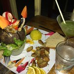 Stone crab claws, shrimp, and snapper presented in a coconut (with frozen Mojito in the backgrou