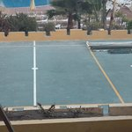 Work being carried out on the volleyball court which did not intrude on the relaxation we wanted