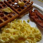 Complimentary Breakfast Buffet featuring make your own waffles, scrambled eggs, fruits &  much m