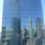 View of several buildings reflected in a building across from our room