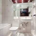 Bathroom with Bathtube in every Suite
