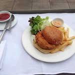 Delicious spicy fish burger by the pool