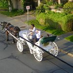 Carriages pass by the hotel