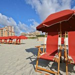 Our Private Beach access with complimentary shuttle service, beach chairs and umbrellas