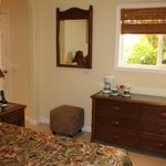 Plumeria Room with firm Queen bed, mini fridge, coffeemaker, access to microwave and barbecue