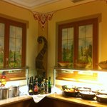 The trompe d'oeil pictures on the dining wall at the buffet.