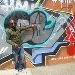 Raheim in front of the Graffiti wall of fame