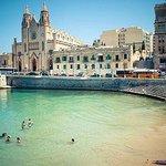 Beach and church near le Meridean Hotel Malta